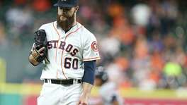 Astros starting pitcher Dallas Keuchel reacts to allowing a homer in the fourth inning against the Minnesota Twins at Minute Maid Park n May 2, 2016, in Houston.