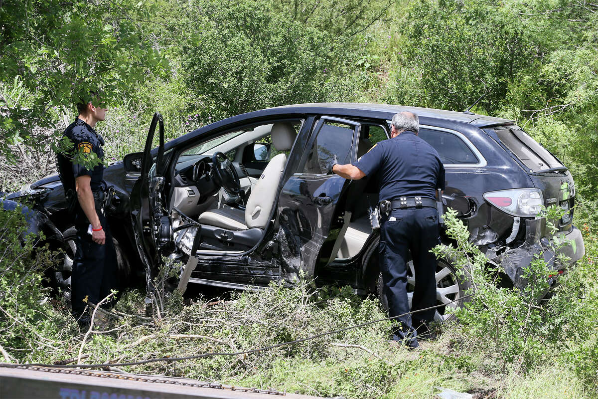 San Antonio police prepare to tow the 2008 Mazda CX-7 that was carjacked by Emanuel Gregory Martinez from the Martin Marietta Beckman Quarry on NW Military Hwy north of Loop 1604 W on Thursday, May 5, 2016 Highway, 2016. Martinez was apprehended there by two patrol cars after a chase that began on the South Side of San Antonio. MARVIN PFEIFFER/ mpfeiffer@express-news.net
