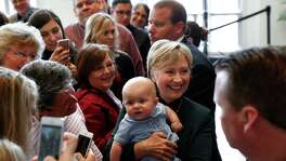 Democratic presidential candidate Hillary Clinton takes photographs with an infant during a campaign stop in Charleston, W.V. If character is an issue in the race, as a recent commentary indicated, then Clinton is doomed, according to a reader.