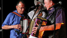 Santiago Jimenez Jr. (left) and his brother Flaco Jimenez performed onstage together for the first time in 30 years at the 2012 Tejano Conjunto Festival.