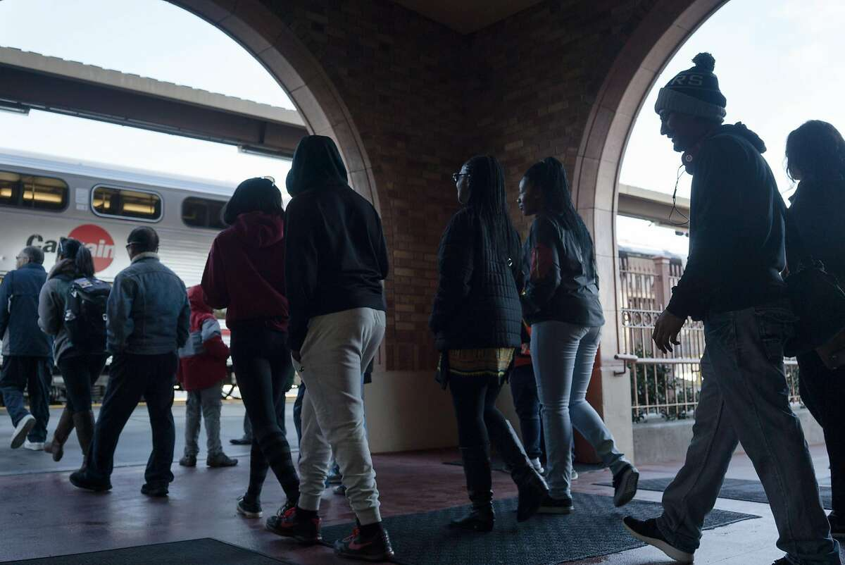 Riders line up for The Celebration Train at the San Jose Diridon Station in San Jose, Calif on Monday, Jan. 18, 2016. The Celebration Train, which goes from San Jose to San Francisco, was supposed to be canceled last year, but has been saved and is running again.