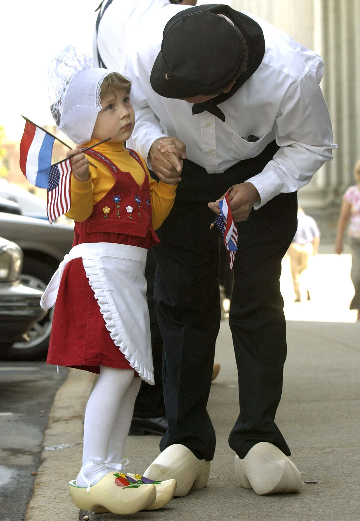 James Schermerhorn of Guilderland speaks with his daughter Lauren, age 4, before the 2004 Tulip Festival kickoff on State Street in Albany. (Will Waldron/Times Union)