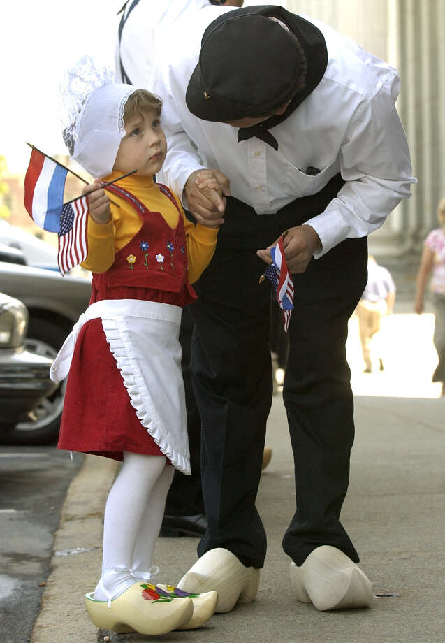 James Schermerhorn of Guilderland speaks with his daughter Lauren, age 4, before the 2004 Tulip Festival kickoff on State Street in Albany. (Will Waldron/Times Union) Photo: WILL WALDRON / ALBANY TIMES UNION