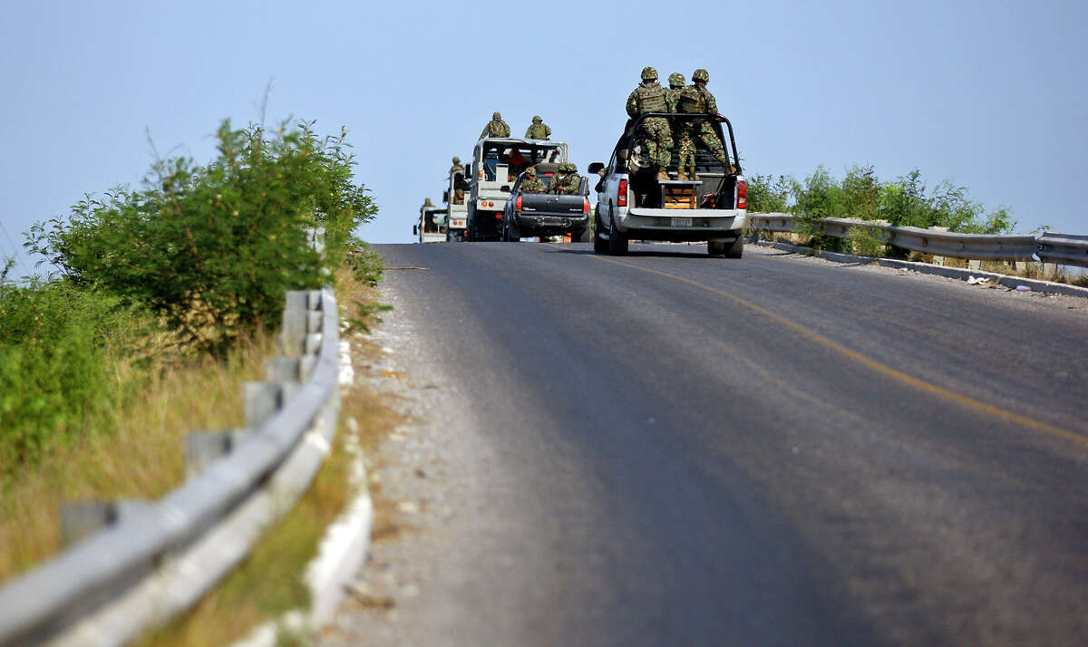 Mexican military patrol a highway on the outskirts of San Fernando, Tamaulipas, Mexico, in this 2011 file photo. A stretch of highway farther south where a Dallas family was kidnapped is in a zone where cartel factions have been fighting.