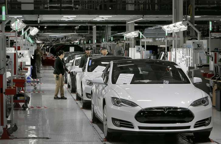 The end of the assembly line where a quality control inspection takes place at Tesla Motors, California's only full-scale auto manufacturing plant, as seen on Thurs. Feb. 19, 2015, in Fremont, Calif.