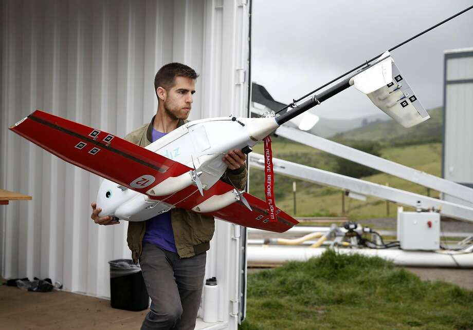 Ryan Oksenhorn prepares a drone airplane developed by Zipline for a test flight in Half Moon Bay, Calif. on Thursday, May 5, 2016. Zipline, the Gavi Vaccine Alliance and UPS are forming a partnership to deliver vaccines and other critical medical supplies to remote areas of Rwanda and other Third World countries using drone aircraft. Photo: Paul Chinn, The Chronicle