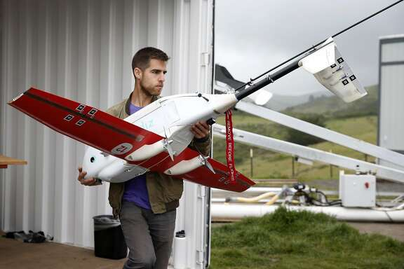 Ryan Oksenhorn prepares a drone airplane developed by Zipline for a test flight in Half Moon Bay, Calif. on Thursday, May 5, 2016. Zipline, the Gavi Vaccine Alliance and UPS are forming a partnership to deliver vaccines and other critical medical supplies to remote areas of Rwanda and other Third World countries using drone aircraft.