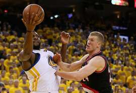OAKLAND, CA - MAY 03:  Festus Ezeli #31 of the Golden State Warriors and Mason Plumlee #24 of the Portland Trail Blazers go for a rebound during Game Two of the Western Conference Semifinals during the 2016 NBA Playoffs on May 3, 2016 at Oracle Arena in Oakland, California.  NOTE TO USER: User expressly acknowledges and agrees that, by downloading and or using this photograph, User is consenting to the terms and conditions of the Getty Images License Agreement.  (Photo by Ezra Shaw/Getty Images)