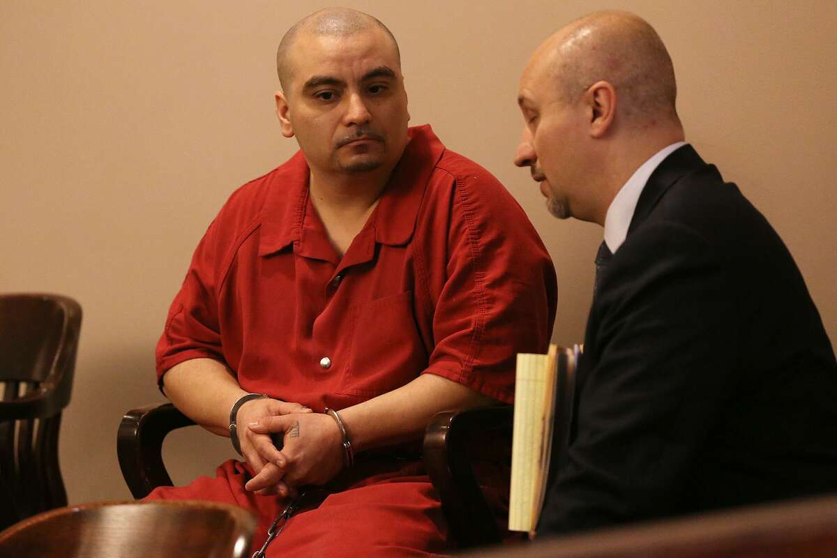 Alfred Cardona, 36, left, talks with his attorney Stephen Foster in the Bexar County 226th District Court, Monday, Sept. 29, 2014. Cardona was sentenced to life in prison in federal court Wednesday morning in connection with the murder of Balcones Heights police officer Julian Pesina, 29. The officer was killed on May 4 outside a San Antonio tattoo parlor he co-owned on Hillcrest Drive.