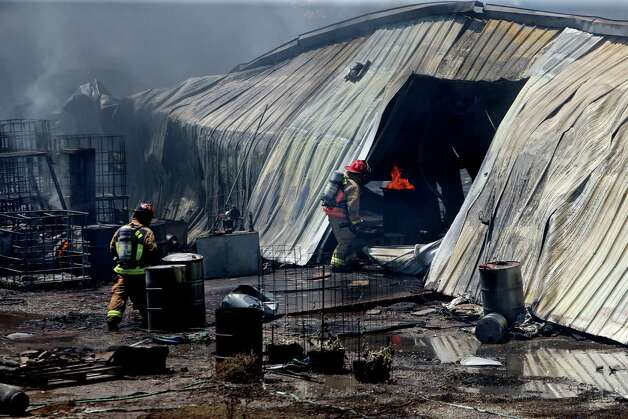 Houston Fire Department battle four-alarm fire that started at a nearby house spreading to the Custom Packaging and Filling Company about 10:50 a.m. in the 1700 block of Laverne near Spring Branch Drive according to the Houston Fire Department, Thursday, May 5, 2016, in Houston, Texas. Photo: Gary Coronado, Houston Chronicle / © 2015 Houston Chronicle