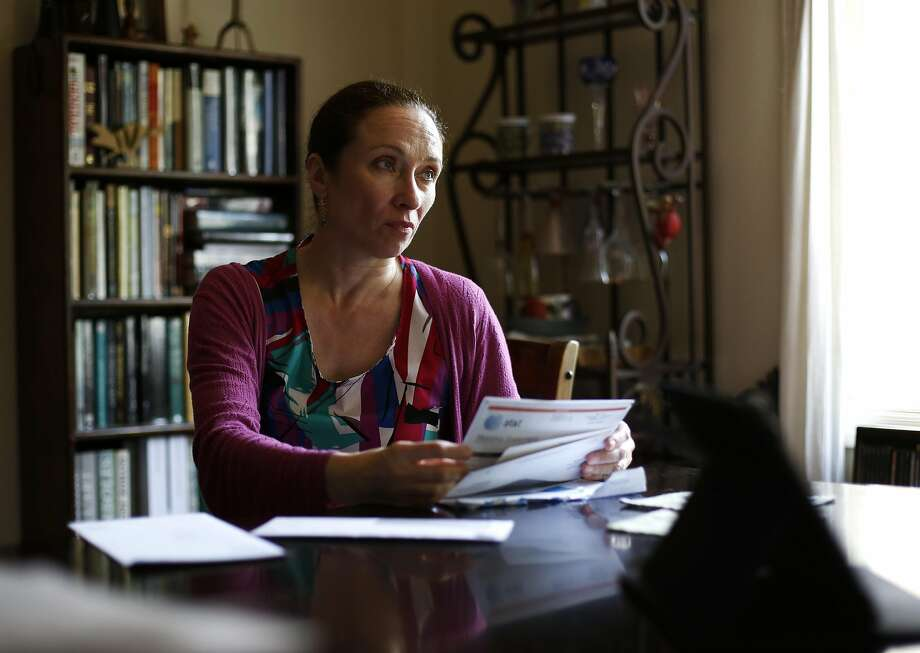 Pascale Leroy goes through paperwork with her husband, Robert Bell. Covered California routed them to Medi-Cal when they tried to renew their policy. Photo: Connor Radnovich, The Chronicle