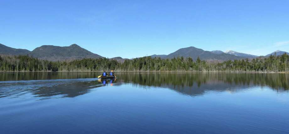 The Boreas Ponds offer some idyllic paddling and fantastic views of the Adirondack High Peaks, including (to the right) Allen, Marcy, Skylight and Haystack. Cheney Cobble is to the right. (Gillian Scott / Special to the Times Union) Photo: Picasa