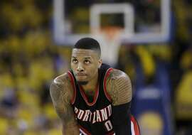 Portland Trail Blazers' Damian Lillard pauses during free throws during the second half in Game 2 of a second-round NBA basketball playoff series against the Golden State Warriors Tuesday, May 3, 2016, in Oakland, Calif. Golden State won 110-99. (AP Photo/Marcio Jose Sanchez)