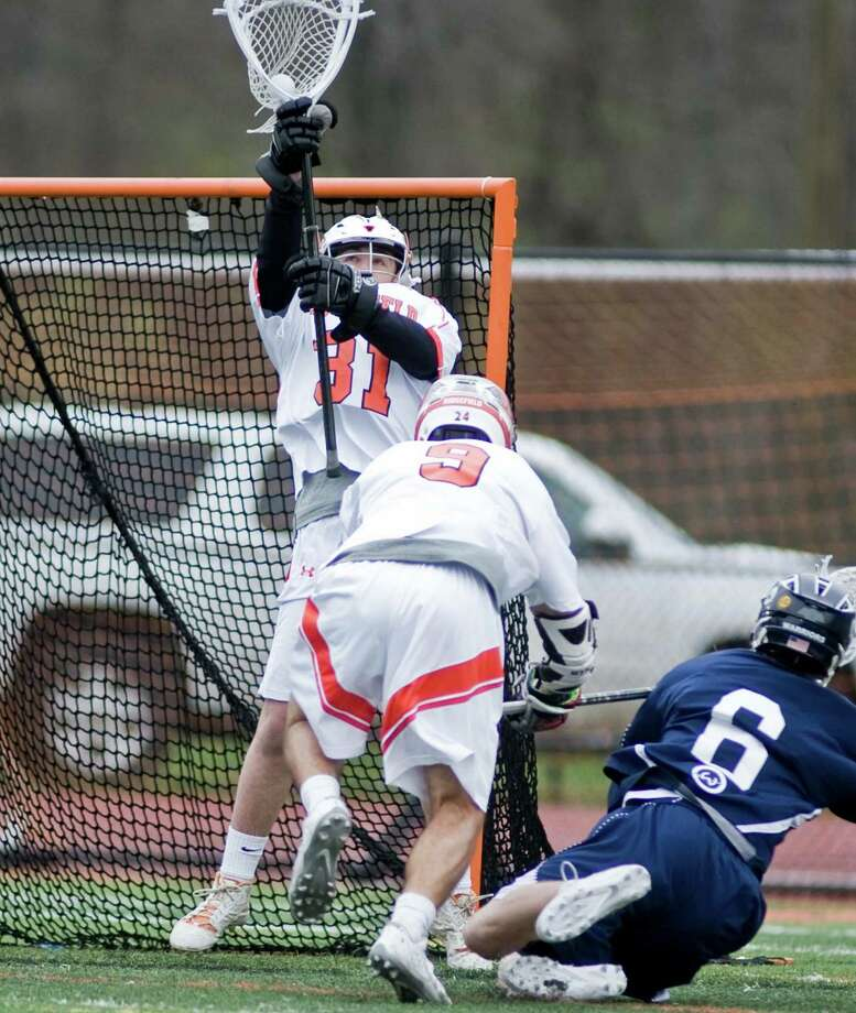 Ridgefield High School boys lacrosse vs Wilton High School during a game at Ridgefield. Thursday, May 5, 2016 Photo: Scott Mullin / For The / The News-Times Freelance