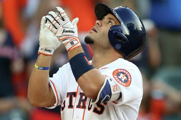 Houston Astros second baseman Jose Altuve (27) reacts as he crosses home plate after hitting a home run in the first inning. Photos of game one between Houston Astros and Seattle Mariners at Minute Maid Stadium on Thursday, May 5, 2016, in Houston.