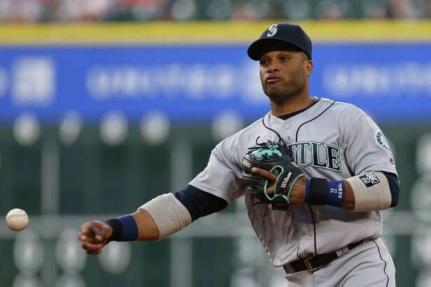 Seattle Mariners second baseman Robinson Cano (22) gets Houston Astros first baseman Tyler White (13) out at first in the second inning. Photos of game one between Houston Astros and Seattle Mariners at Minute Maid Stadium on Thursday, May 5, 2016, in Houston.