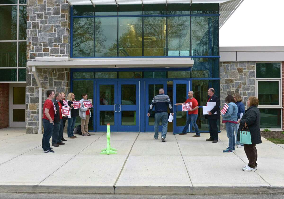 Teachers and parents wait in front of Meeting House Hill School for the start of the New Fairfield Board of Education meeting on May 5, 2016.