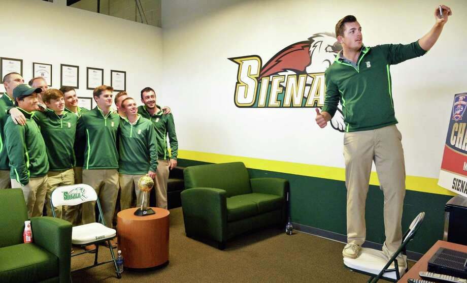 Spencer Sautin, right, of Ballston Lake, takes a selfie with team mates of the MAAC Champion Siena Men's Golf team as they learn that they're headed to Tucson, Arizona for the NCAA Tournament Thursday May 5, 2015 in Colonie, NY.  (John Carl D'Annibale / Times Union) Photo: John Carl D'Annibale / 20036486A