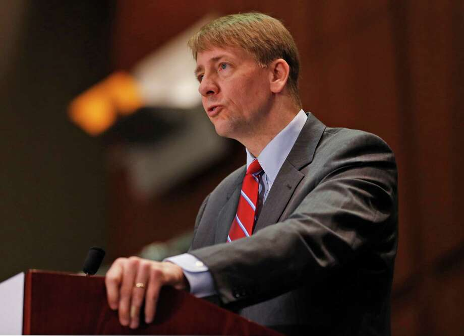 FILE - In this March 26, 2015, file photo, Consumer Financial Protection Bureau Director Richard Cordray speaks during a panel discussion in Richmond, Va. The CFPB is proposing a ban on arbitration clauses, which would impact the entire financial industry encompassing hundreds of millions of bank accounts, credit cards and mortgages. (AP Photo/Steve Helber, File) ORG XMIT: NYBZ449 Photo: Steve Helber / Copyright 2016 The Associated Press. All rights reserved. This m
