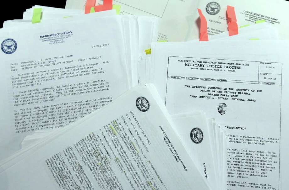 FILE - In this Jan. 29, 2014, file photo, parts of more than 1,000 summeries of sex-crime cases involving U.S. military personnel stationed in Japan, which The Associated Press obtained following Freedom of Information Act requests filed with the Army, Navy, Air Force, Marines and Naval Criminal Investigative Service, are displayed at the AP office in Tokyo. Reports of sexual assaults in the military rose 50 percent after the Pentagon began a vigorous campaign to get more victims to come forward, prompting defense officials to order a greater focus on prevention programs, including plans to review alcohol sales and policies.  (AP Photo/Shizuo Kambayashi) ORG XMIT: WX101 Photo: Shizuo Kambayashi / AP