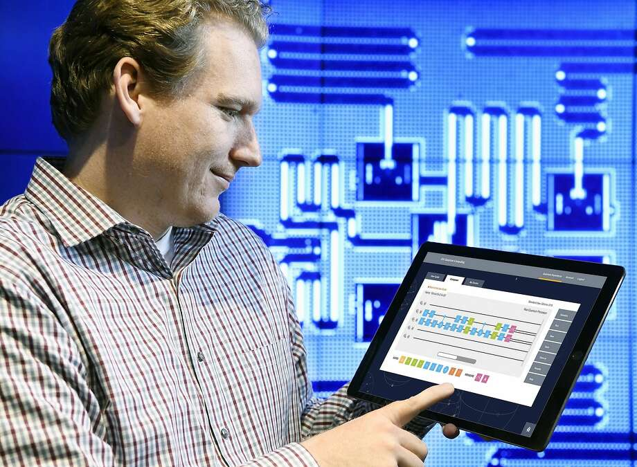 IBM quantum computing scientist Jay Gambetta demonstrates the online version of the IBM Quantum Experience on a tablet. Photo: JON SIMON, Associated Press