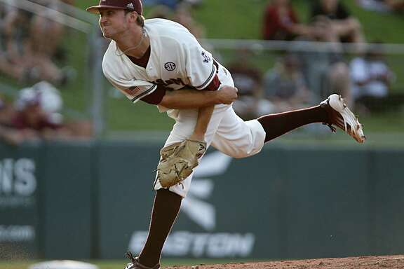 Andrew Vinson, the second of three A&M pitchers who combined on a six-hit shutout, throws in the fourth inning.