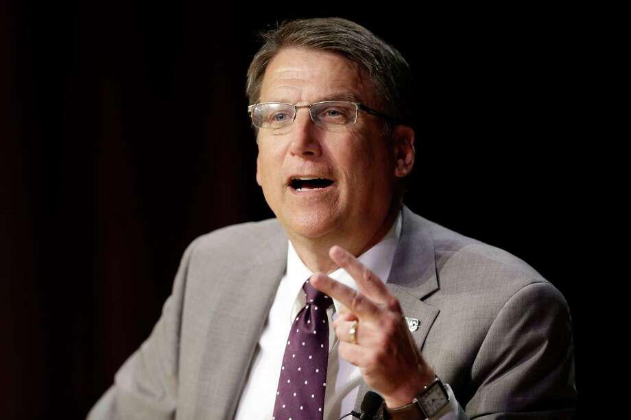 North Carolina Gov. Pat McCrory makes remarks concerning House Bill 2 while speaking during a government affairs conference in Raleigh, N.C., Wednesday, May 4, 2016. A North Carolina law limiting protections to LGBT people violates federal civil rights laws and can't be enforced, the U.S. Justice Department said Wednesday, putting the state on notice that it is in danger of being sued and losing hundreds of millions of dollars in federal funding. (AP Photo/Gerry Broome) ORG XMIT: NCGB110 Photo: Gerry Broome / Copyright 2016 The Associated Press. All rights reserved. This m