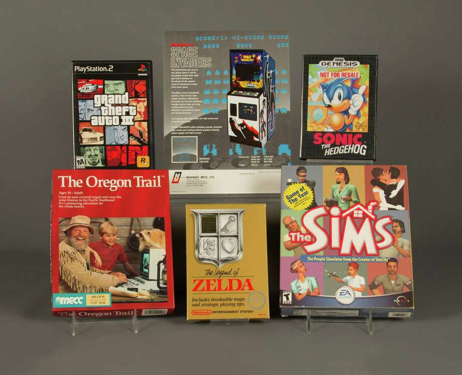 """In this April 21, 2016 photo provided by The Strong museum in Rochester, N.Y., the 2016 inductees to the World Video Game Hall of Fame are displayed. From top left, clockwise, are """"Grand Theft Auto III,""""  """"Space Invaders,"""" """"Sonic the Hedgehog,"""" """"The Sims,"""" """"The Legend of Zelda,"""" and """"The Oregon Trail."""" (Bethany Mosher/The Strong museum via AP) MANDATORY CREDIT ORG XMIT: NYR401 Photo: Bethany Mosher / The Strong museum"""