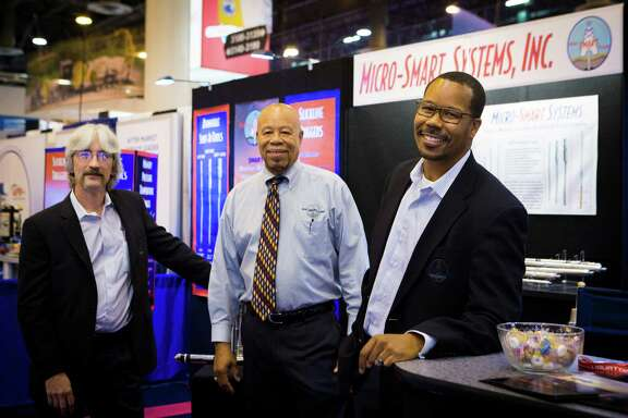 Micro-Smart Systems, Inc. senior marketing engineer Kevin Anderson, right, Otis Anderson, vice president engineering and Clarence Foytik design engineer, at the 2016 Offshore Technology Conference, Thursday, May 5, 2016, in Houston. ( Marie D. De Jesus / Houston Chronicle )