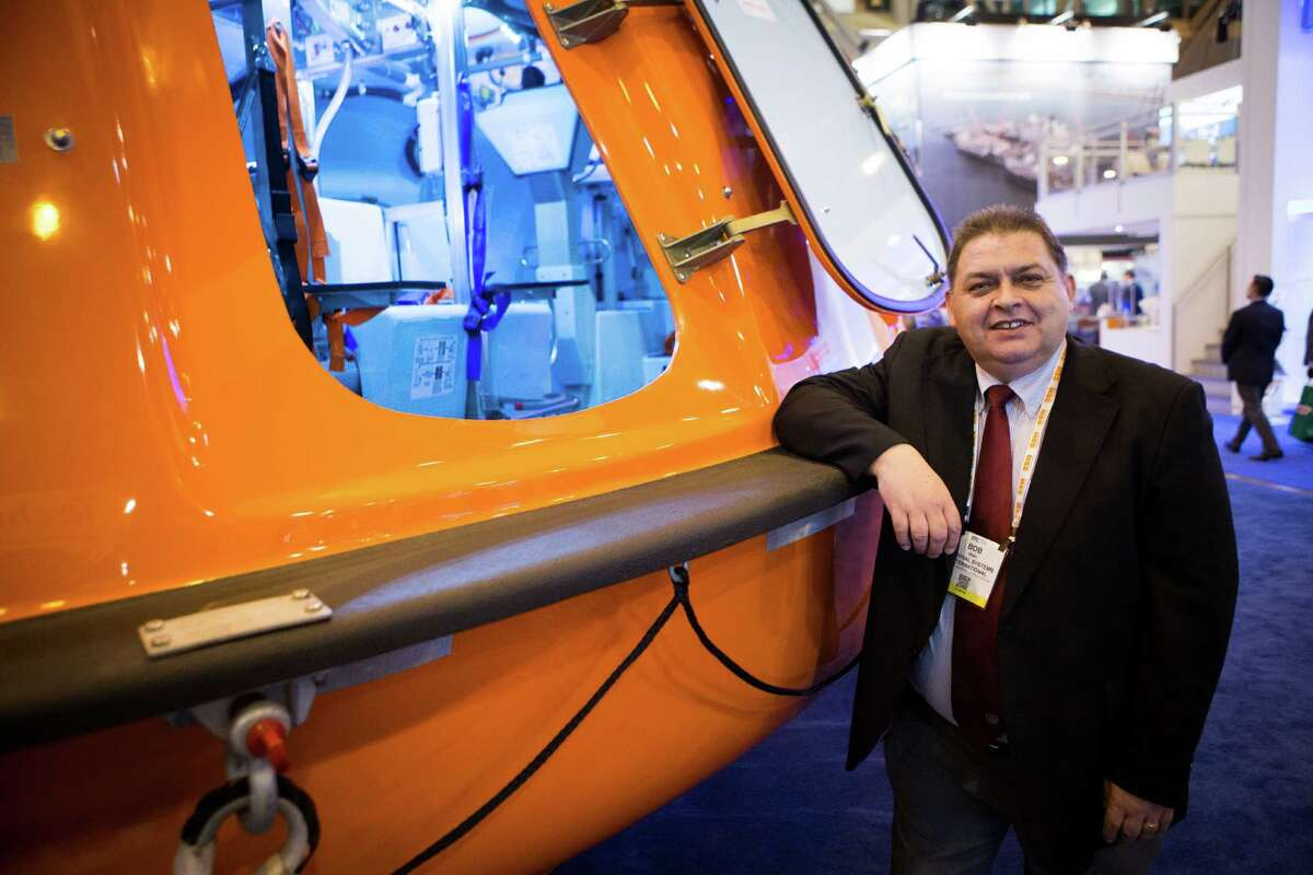 Survival Systems International vice president regulatory compliance Bob Gray stands next to a 60 person survival capsule during the 2016 Offshore Technology Conference, Thursday, May 5, 2016, in Houston. ( Marie D. De Jesus / Houston Chronicle )