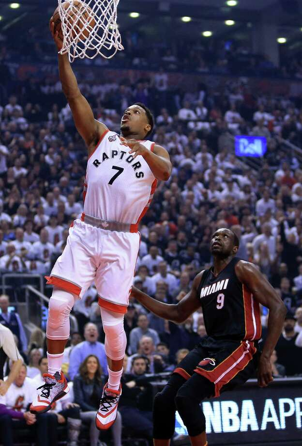 TORONTO, ON - MAY 05:  Kyle Lowry #7 of the Toronto Raptors shoots the ball as Luol Deng #9 of the Miami Heat defends in the first half of Game Two of the Eastern Conference Semifinals during the 2016 NBA Playoffs at the Air Canada Centre on May 5, 2016 in Toronto, Ontario, Canada.  NOTE TO USER: User expressly acknowledges and agrees that, by downloading and or using this photograph, User is consenting to the terms and conditions of the Getty Images License Agreement.  (Photo by Vaughn Ridley/Getty Images) ORG XMIT: 636229409 Photo: Vaughn Ridley / 2016 Getty Images