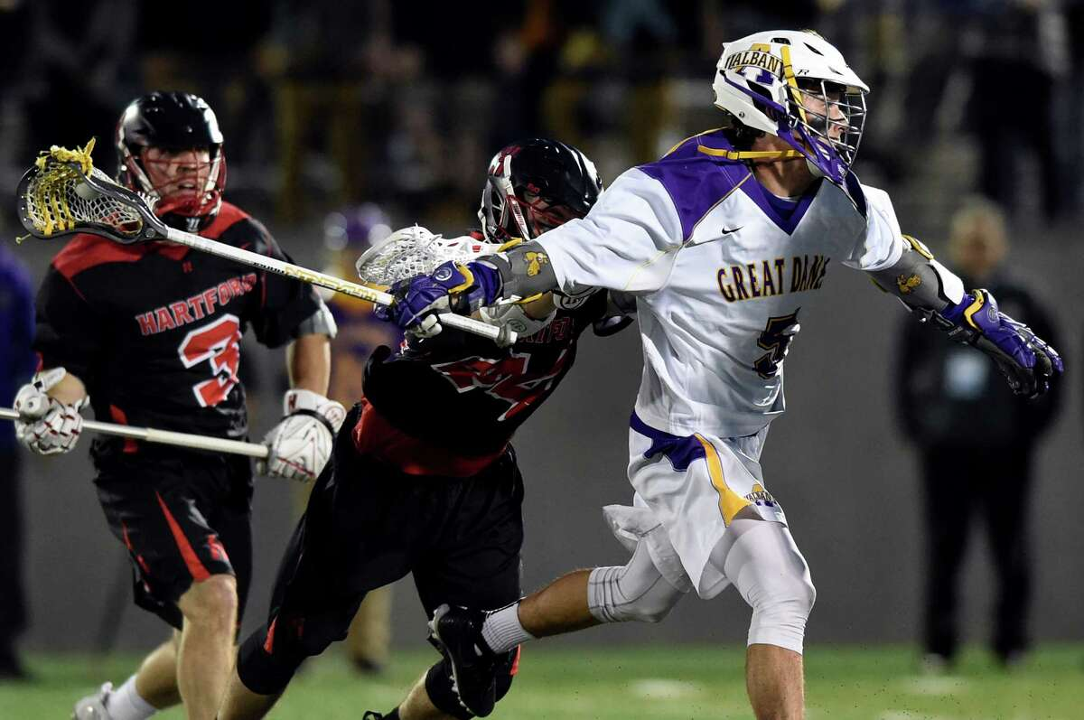 UAlbany's Connor Fields, right, winds up for a shot on goal as Hartford's Conor Daley, left, and Conor Van Duzer defend during their America East lacrosse semifinal on Thursday, May 5, 2016, at Casey Stadium in Albany, N.Y. (Cindy Schultz / Times Union)
