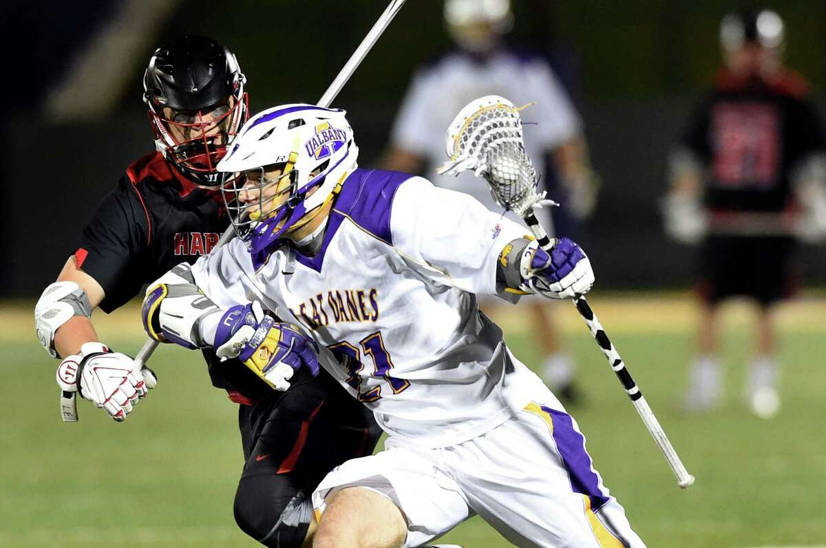 UAlbany's Seth Oakes, right, controls the ball as Hartford's Claude Bradshaw defends during their America East lacrosse semifinal on Thursday, May 5, 2016, at Casey Stadium in Albany, N.Y. (Cindy Schultz / Times Union)