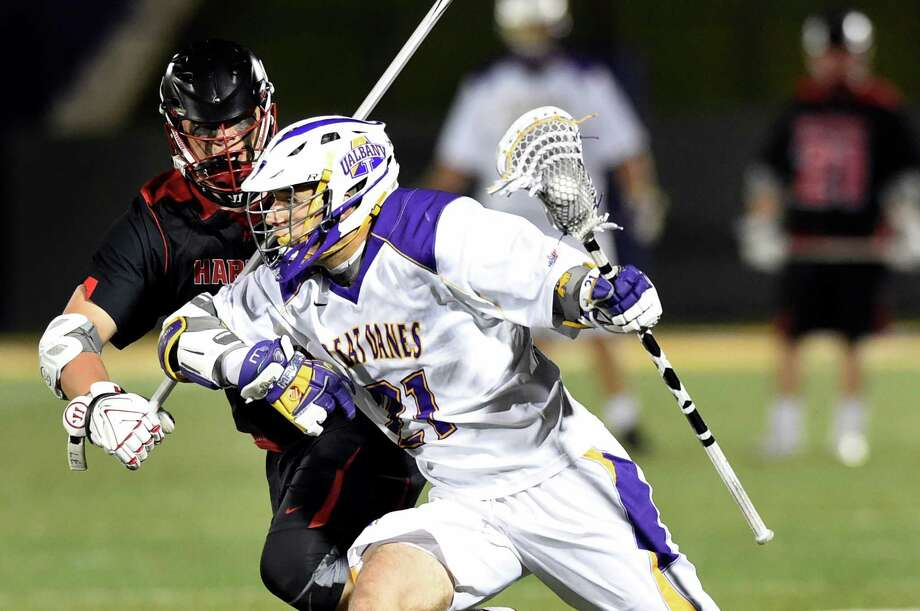 UAlbany's Seth Oakes, right, controls the ball as Hartford's Claude Bradshaw defends during their America East lacrosse semifinal on Thursday, May 5, 2016, at Casey Stadium in Albany, N.Y. (Cindy Schultz / Times Union) Photo: Cindy Schultz / Albany Times Union