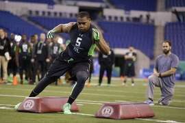 Appalachian State defensive lineman Ronald Blair runs a drill at the NFL football scouting combine in Indianapolis, Sunday, Feb. 28, 2016. (AP Photo/Michael Conroy)