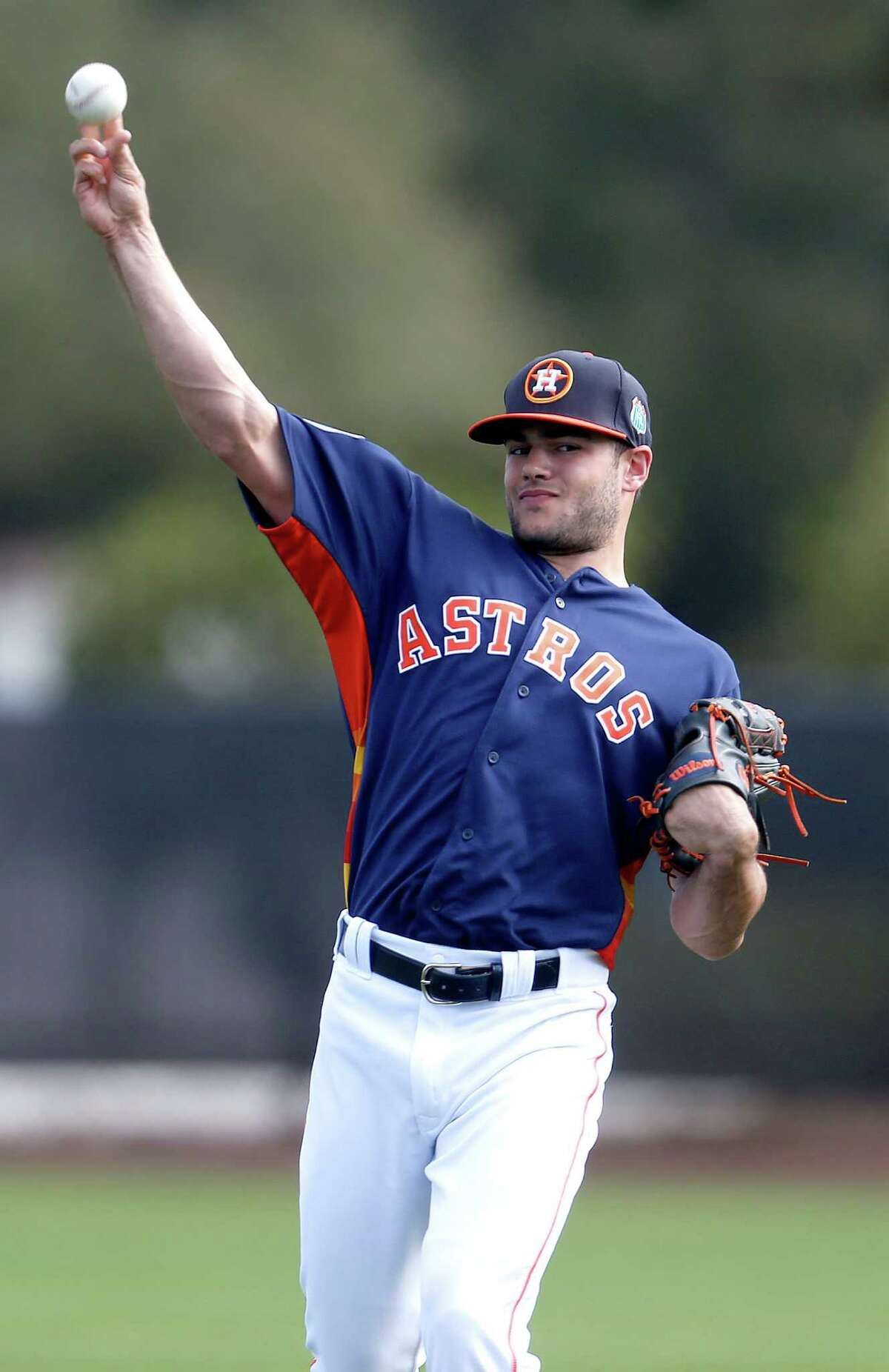 Houston Astros pitcher Lance McCullers throws long toss warmups during spring training in Kissimmee, Florida, Sunday, Feb. 21, 2016.( Karen Warren / Houston Chronicle )