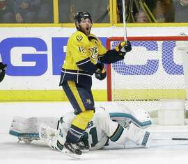 Nashville Predators forward Mike Fisher (12) celebrates after a shot by teammate James Neal, not shown, got past San Jose Sharks goalie Martin Jones (31) for a goal during the third period in Game 4 of an NHL hockey Stanley Cup Western Conference semifinal playoff series Thursday, May 5, 2016, in Nashville, Tenn.