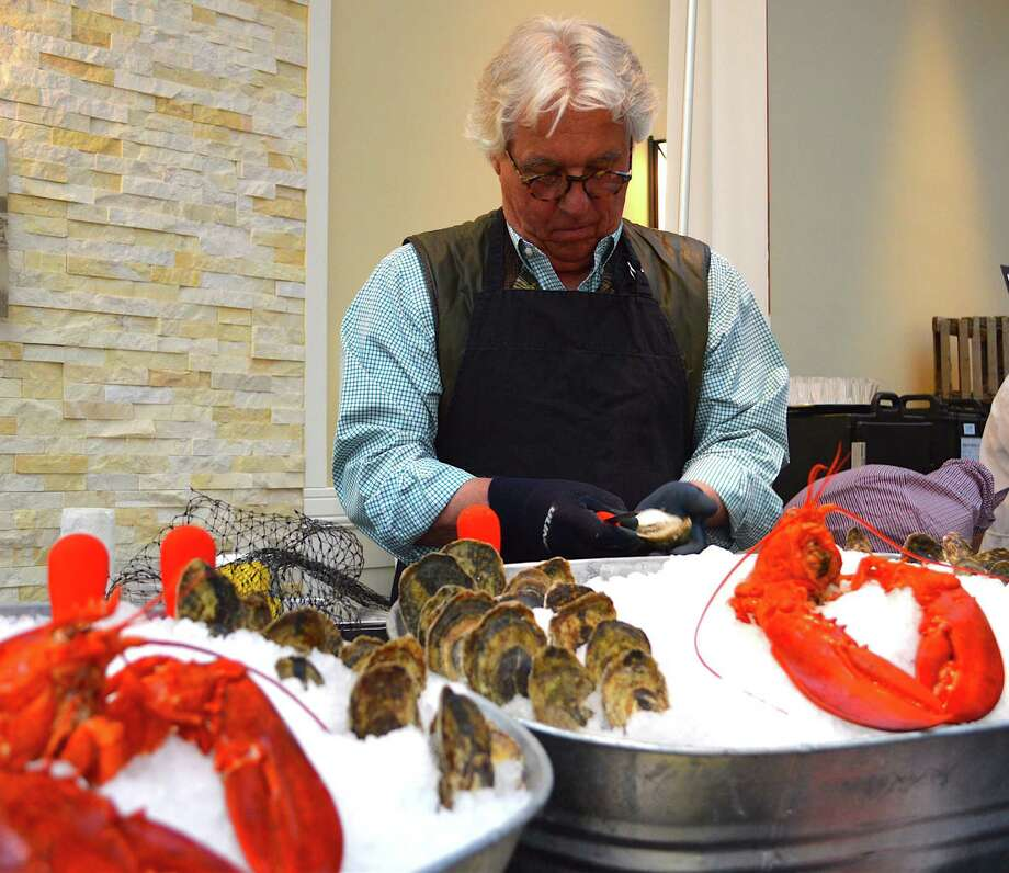 "Jeff Northrop, an oyster farmer with Hummock Island shellfish in Westport, said it was ""an honor"" to contribute his time and food to the Taste of Westport benefiting CLASP Homes. Photo: Westport News / Jarret Liotta / Westport News"
