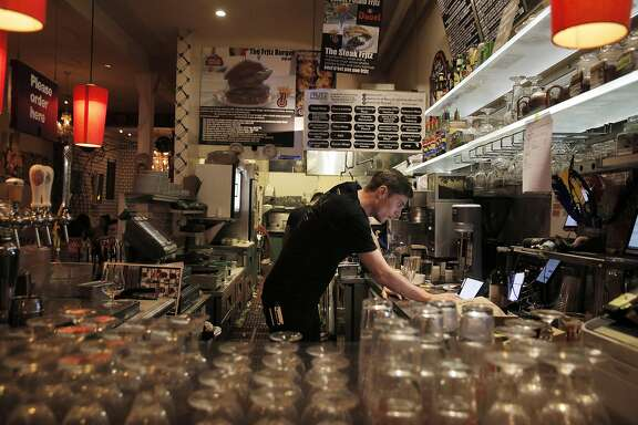 Anthony Wright prepares orders that came in over the internet at Frjtz restaurant in San Francisco, Calif., on Wednesday, May 4, 2016.