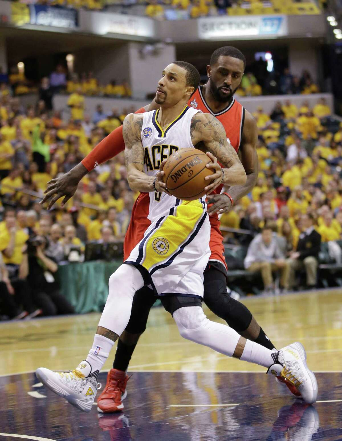 Indiana Pacers' George Hill (3) goes to the basket against Toronto Raptors' Patrick Patterson (54) during the second half of Game 6 of an NBA first-round playoff basketball series Friday, April 29, 2016, in Indianapolis. Indiana won 101-83. (AP Photo/Darron Cummings)