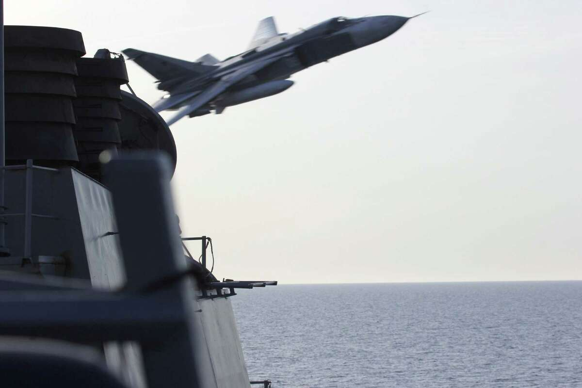A Russian Sukhoi Su-24 attack aircraft makes a very-low altitude pass by the USS Donald Cook (DDG 75),an Arleigh Burke-class guided-missile destroyer, operating in the Baltic Sea April 12, 2016. A United States Navy Destroyer operating in international waters in the Baltic Sea experienced several close interactions by Russian aircraft on April 11 and 12. USS Donald Cook (DDG 75) encountered multiple, aggressive flight maneuvers by Russian aircraft that were performed within close proximity of the ship. On April 11, Donald Cook was conducting deck landing drills with an Allied military helicopter when two Russian SU-24 jets made numerous, close-range and low altitude passes at approximately 3 p.m. local. One of the passes, which occurred while the Allied helicopter was refueling on the deck of Donald Cook, was deemed unsafe by the ships commanding officer. As a safety precaution, flight operations were suspended until the SU-24s departed the area. / AFP PHOTO / US NAVY 6TH FLEET / HandoutHANDOUT/AFP/Getty Images ORG XMIT: Russian j
