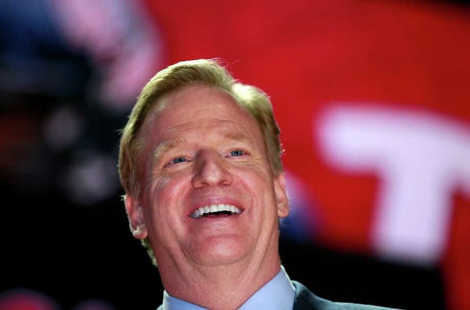 NFL commissioner Roger Goodell announces a selection during the first round of the 2016 NFL football draft, Thursday, April 28, 2016, in Chicago. (Jeff Haynes/AP Images for Panini) Photo: Jeff Haynes, Associated Press / FR171008 AP