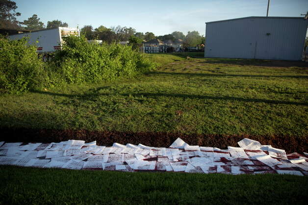 Absorbent pads fill a drainage ditch Friday, May 6, 2016 in Houston in an attempt to soak up chemicals that made it into the water after a four-alarm fire destroyed Custom Packaging and Filling Company yesterday. Photo: Michael Ciaglo, Houston Chronicle / © 2016  Houston Chronicle