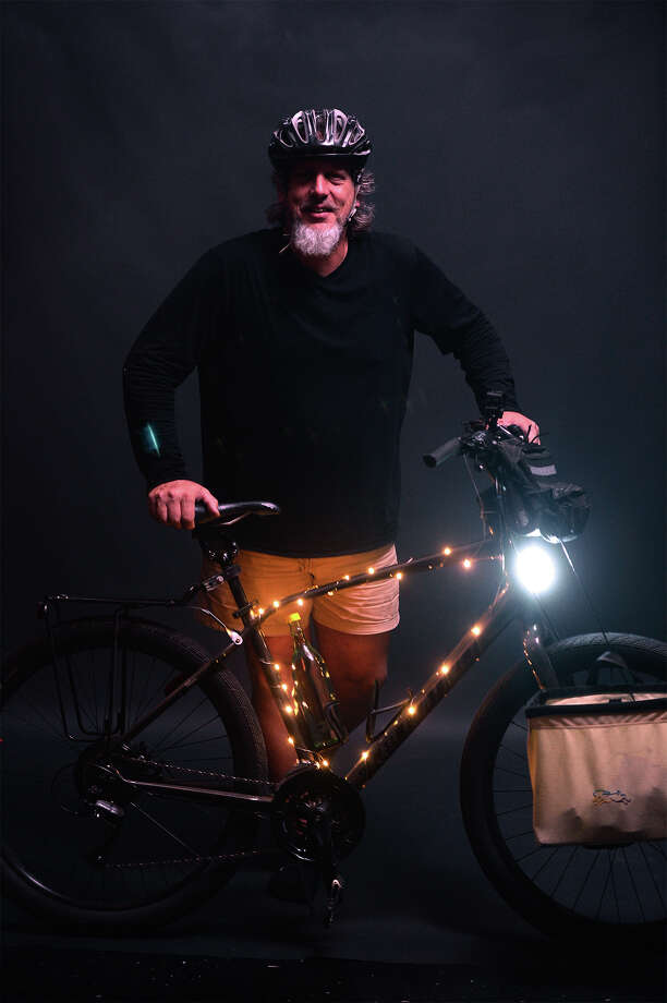 Eric Bender with his lit up bicycle. The Moonlight Madness Bike Ride will be Friday, May 6. Photo taken Tuesday, May 03, 2016 Guiseppe Barranco/The Enterprise Photo: Guiseppe Barranco, Photo Editor