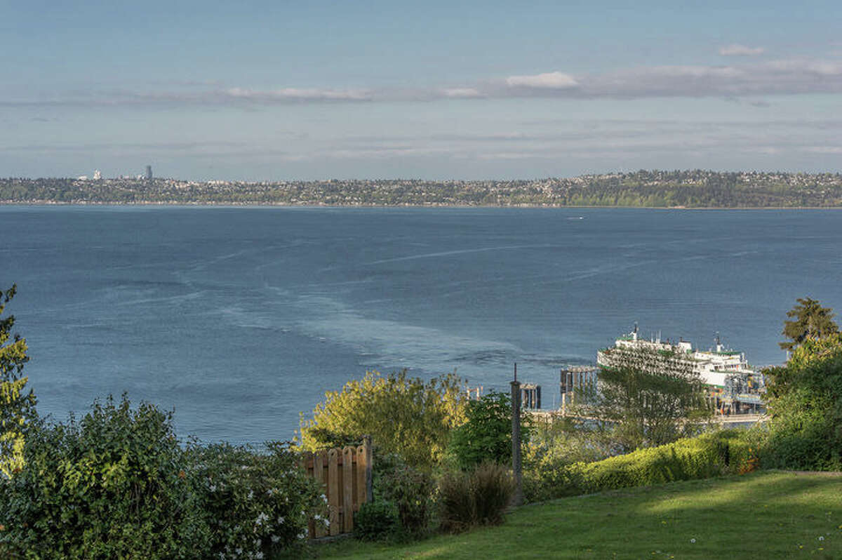 The home at 10620 S.W. Cowan Road offers views of Seattle and the sound.