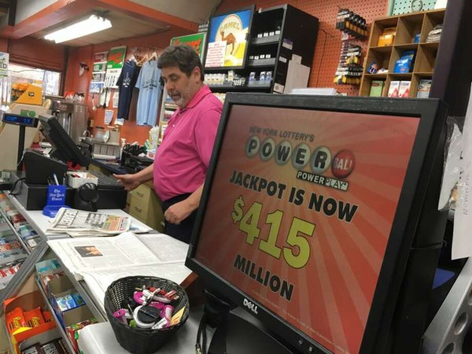 Customers buy PowerBall tickets at Coulson's in downtown Albany on Friday, May 6, 2016. (Michael P. Farrell/Times Union)