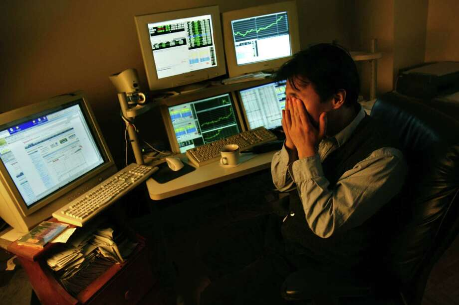 Long hours staring at computer screens cause daytrader Ziyue Fu's eyes to hurt. Photo: Carolyn Cole / Los Angeles Times / Los Angeles Times