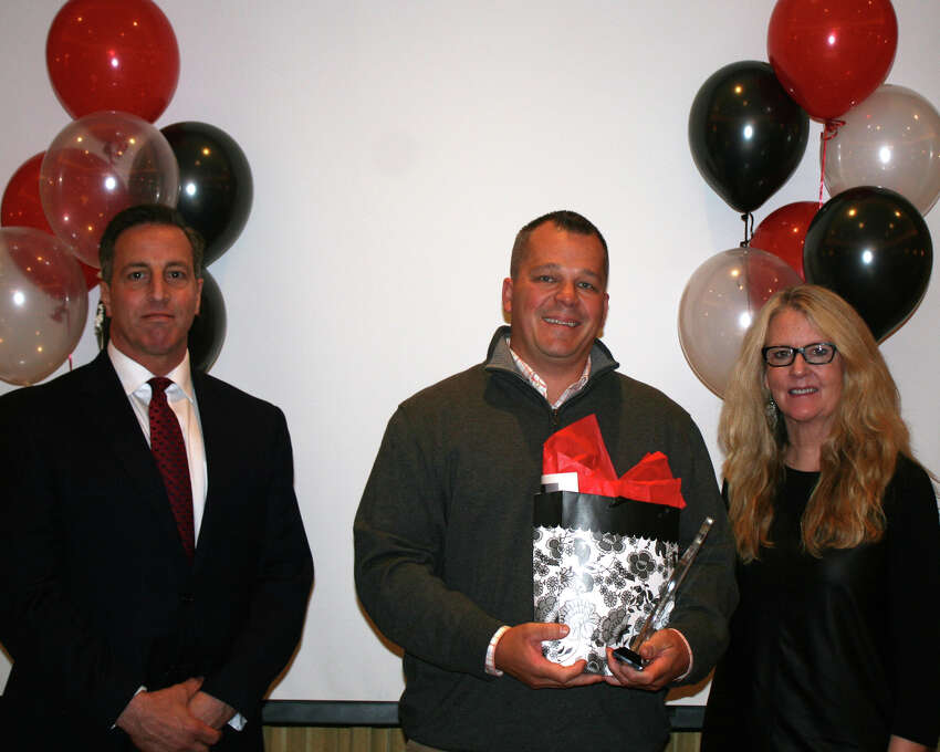 John Apinis, RN Case Manager at Western Connecticut Home Care, Danbury, accepting his award.