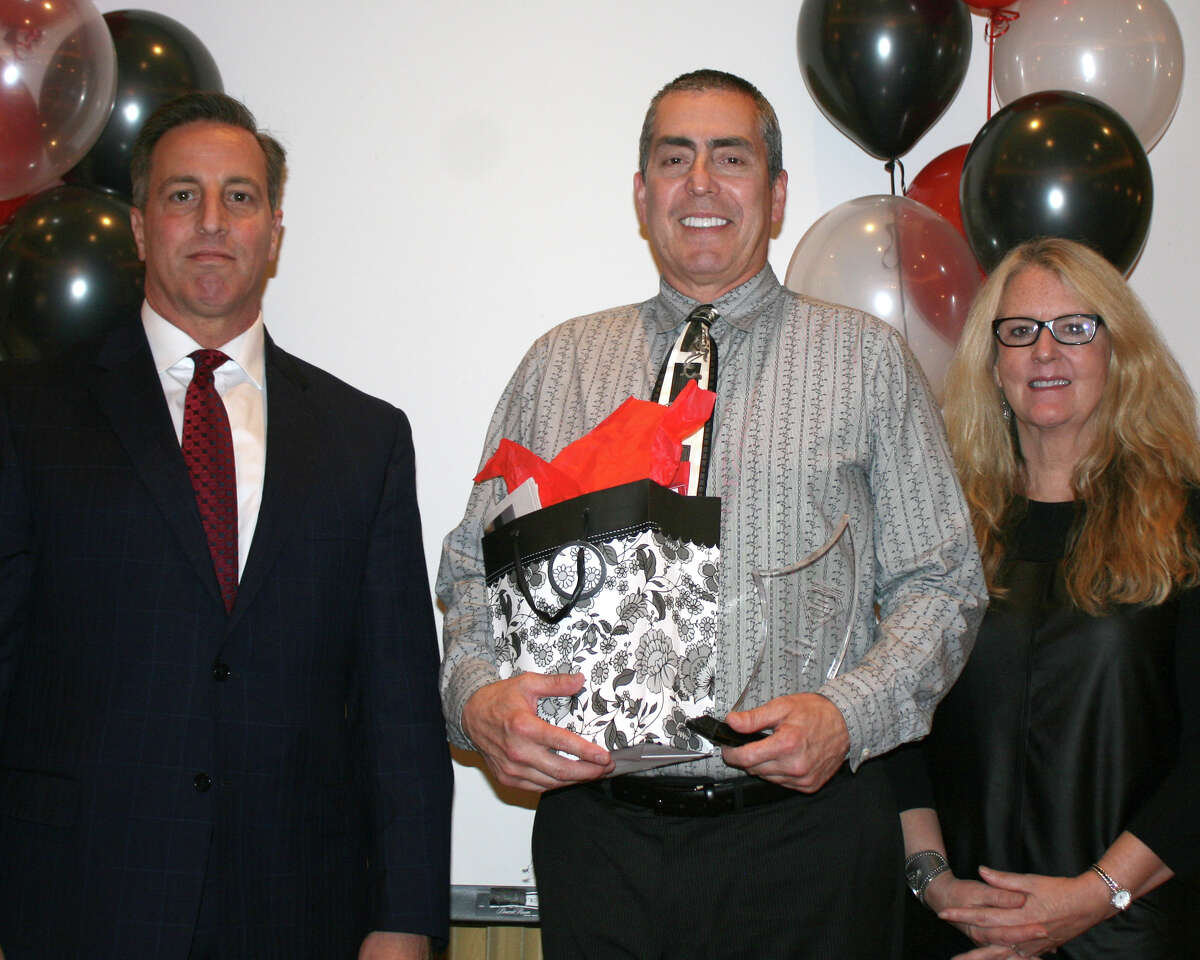 Jim D'Avignon, RN, Orthopedics, at St. Vincent's Medical Center, Bridgeport, accepting his award.
