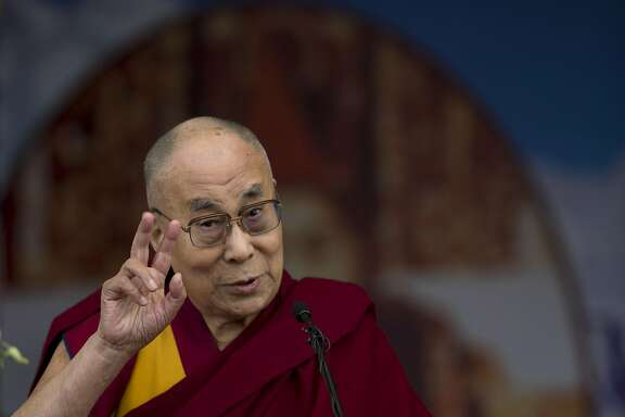 Tibetan spiritual leader the Dalai Lama speaks during a celebration to mark the 100 years of Tibetan Medical and Astrological Institute in Dharamsala, India, Wednesday, March 23, 2016. The institute, called Men-Tsee-Khang in Tibetan, was founded in 1916 by the 13th Dalai Lama in Lhasa. After his exile, the 14th Dalai Lama reestablished the institute in 1961 in India. (AP Photo /Tsering Topgyal)
